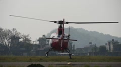 Take off of a small helicopter from the ground Arkistovideo