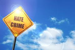 Yellow road sign with a blue sky and white clouds: Hate crime ba Stock Illustration