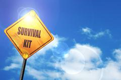 Yellow road sign with a blue sky and white clouds: Survival kit Stock Illustration
