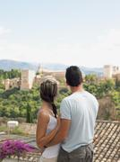 Couple looking at alhambra palace - stock photo