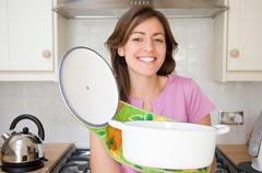 Woman holding casserole dish Stock Photos