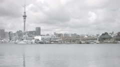 Auckland City Skyline view with harbour and highway in the foreground Stock Footage
