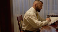 Businessman viewing some documents at home office  Stock Footage