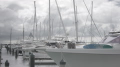 Yachts and boats moored in a marina Stock Footage