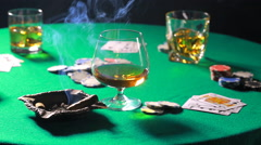 Smoking a cigar on the table to play poker with whiskey Stock Footage