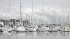 Yachts and boats moored in a row Stock Footage