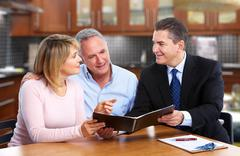 Senior couple with insurance agent. Stock Photos