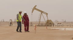 Oil Workers At Well Pump Jack Site Stock Footage
