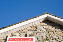 For sale sign on house Stock Photos