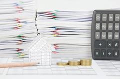 Pencil and house with step pile of gold coins Stock Photos