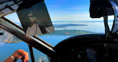 4K Cockpit of Small Plane, Pilot's Hand, Flying Aircraft over Pacific Islands - stock footage