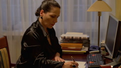 Businesswoman conquer the documents at work in the home office  - stock footage