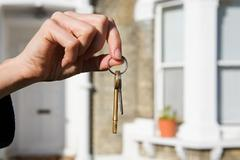 Person with keys to house Stock Photos