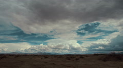 Time lapse storm clouds travel over a desert plain - Time Lapse 2059 HD, 4K Stock Footage