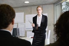 Woman giving a presentation Stock Photos