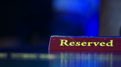 Reserved sign on a table in restaurant behind dance-floor. Stock Footage