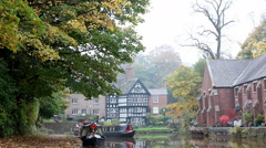 Canal narrow boats in autumn Stock Footage