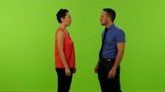 man and asian woman conversation greenscreen 4K - stock footage