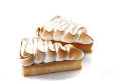 Triangular cake with custard on the top. - stock photo