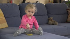 Hysterical baby girl cry using smart phone on sofa. Stock Footage