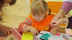 Little kid painting Stock Footage