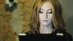Young attractive woman reads the news on the tablet Stock Footage