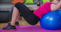 Working out on a ball for a nice abs - stock footage