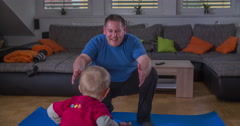 Boy is running to his father to lift him up Stock Footage