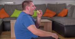 Eating a hamburger and trying to work out at the same time Stock Footage
