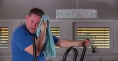 Wiping his forehead when working out on an orbit track Stock Footage