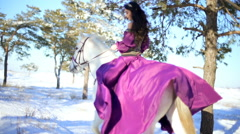 Beautiful woman on a white horse in winter Stock Footage