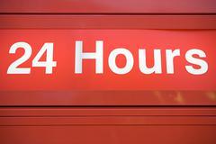 Twenty four hour sign Stock Photos
