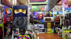 Copy artist shop pan of complete paintings - stock footage