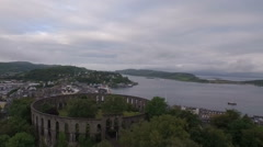 Aerial shot of McCaigs tower in Oban on the west coast of Scotland Stock Footage