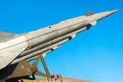 anti aircraft rockets of a surface-to-air missile system are aimed at the blu - stock photo