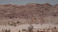Wide shot of the Royal Tombs in the lost city of Petra Stock Footage
