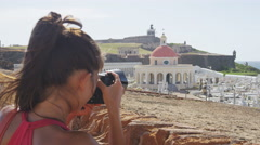 Puerto Rico tourist taking photo at Old San El Morro and Cemetery Stock Footage