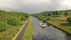 Aerial shot of cyclists going on Crinan canal in Scotland on the west coast Stock Footage