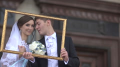 Bride and groom in the picture frame - stock footage