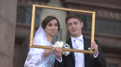 Newlyweds in a picture frame - stock footage