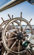 Steering wheel of an old sailing vessel - stock photo