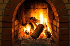 Burning billets in fire-box of fireplace Stock Photos