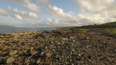 Incredible aerial shot along the coast in Scotland Stock Footage