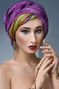 Beautiful fashion east  woman portrait with oriental accessories- earrings, b Kuvituskuvat