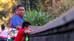 Father speaks with his son in the park. Stock Footage