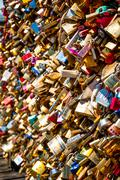 Love padlocks on parisian bridge - stock photo