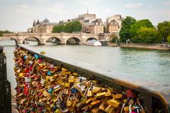 Padlocks in front of Pont de Arts bridge, Paris - stock photo