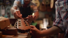 3-Boy Helping Senior Man Grandpa Changing Guitar String Stock Footage