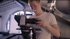 Behind the scenes. Operator checks the camera settings before shooting - stock footage