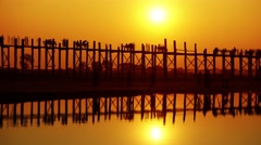 Famous U-Bein teak bridge at sunset, timelapse Stock Footage
